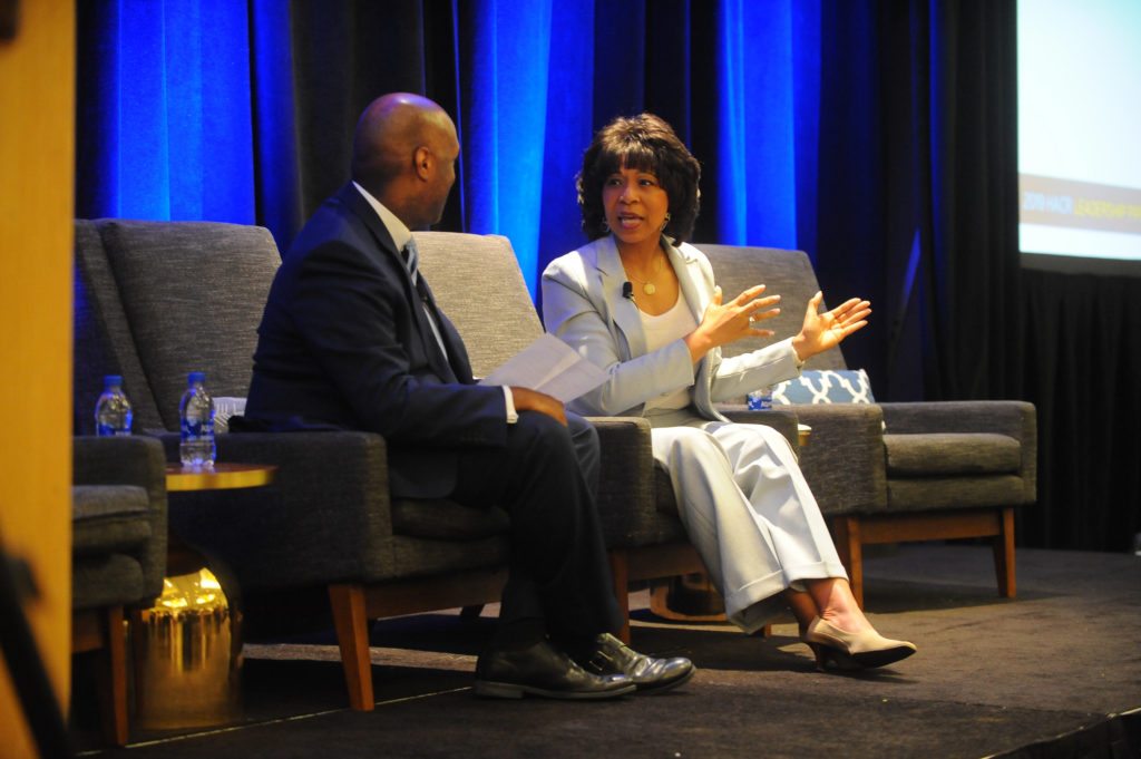 Two people speaking at an event