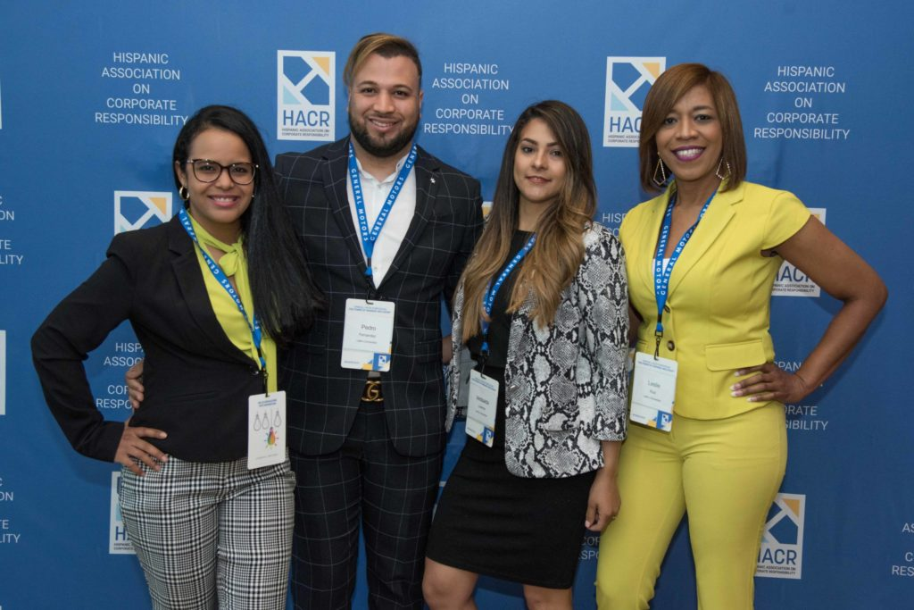 Group of four posing for photo at HACR event