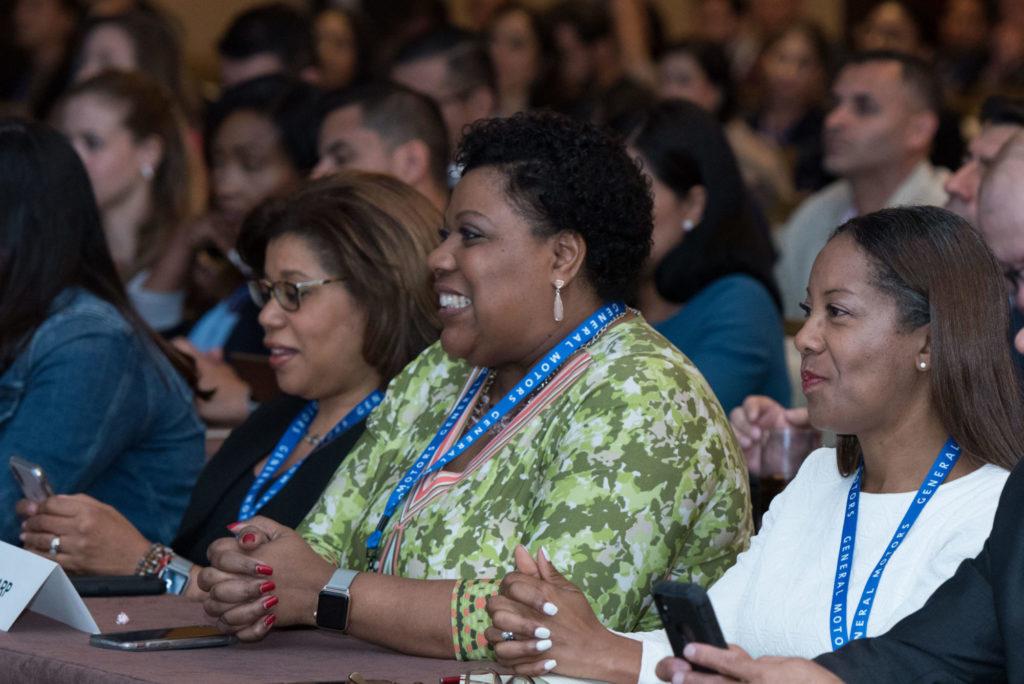 Smiling women at a speech