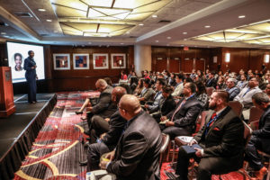 Speaker at a large indoor conference
