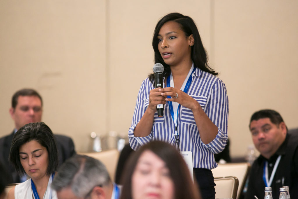 Woman speaks at HACR Young Hispanics event