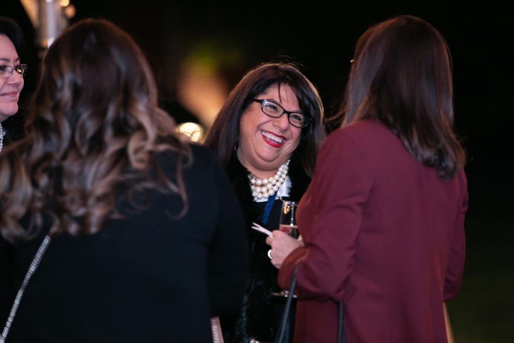 Woman laughing to others