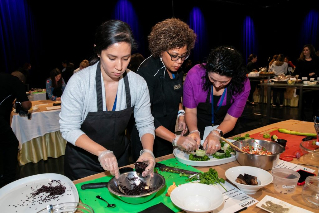 Women prepping food at a convention event