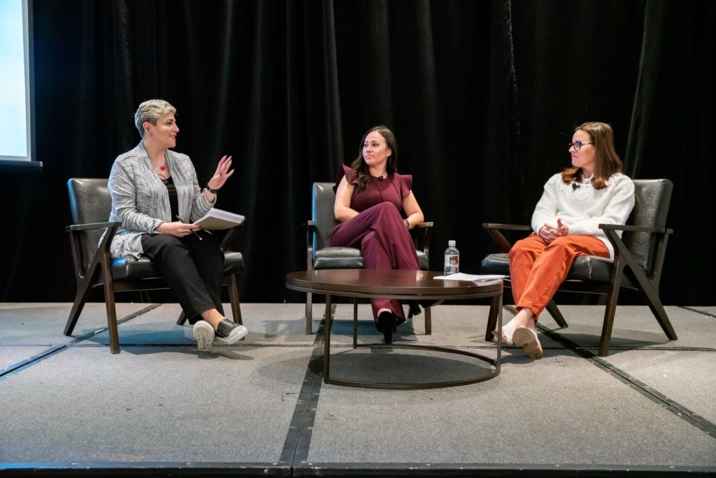 3 women speakers at an event